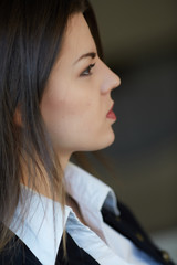 Young business woman in profile