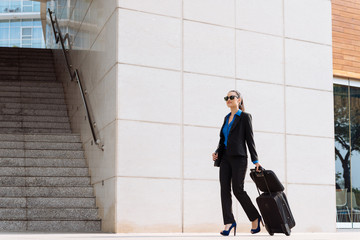 Business woman with luggage