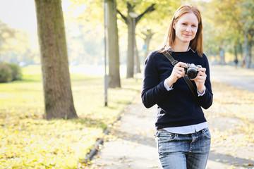 Happy Amateur Photographer in a Park