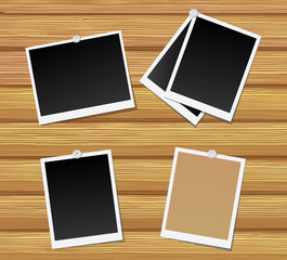 Blank photos on a wooden wall.