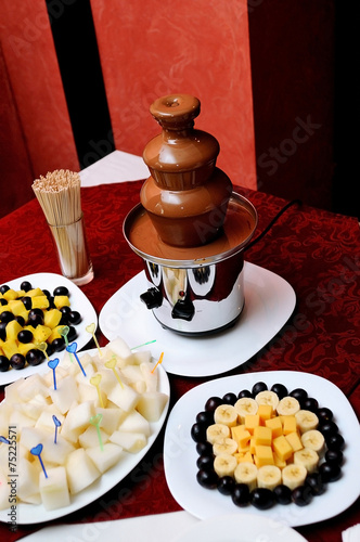 Chocolate Fountain And Fruits At Wedding Reception Stock Photo And