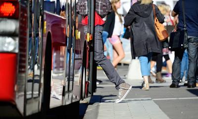 Person enters bus