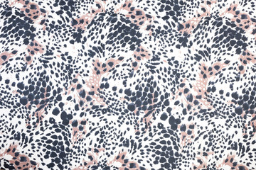 Background of black spotted animal fur print