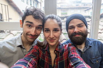 Three young friends take a Selfie from the office
