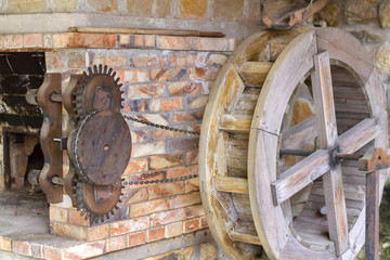 Water wheel with chain and gears