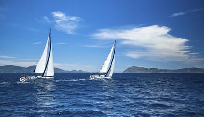 Boats in sailing regatta. Luxury yachts.