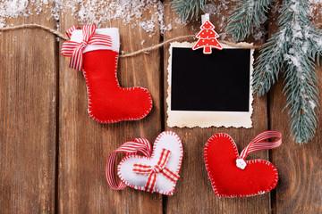 Blank photo frames and Christmas decor with snow fir tree