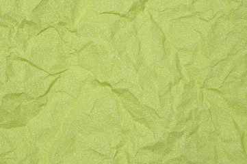 Green crumpled paper as background