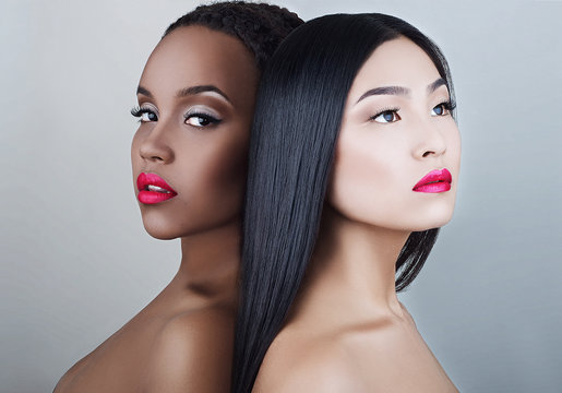 Portrait of young african and korean girls