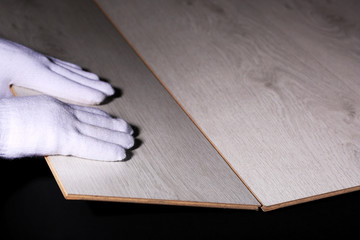 Carpenter worker installing laminate flooring