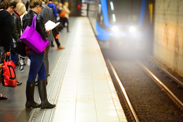 Commuters waiting for train, on platform
