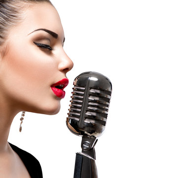 Singing woman with retro microphone. Beauty singer girl
