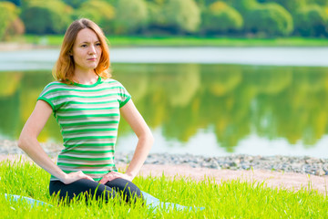 girl in green t-shirt at the lush grass playing sports