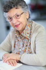 Portrait of elderly woman reading book