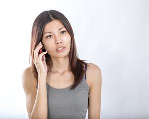Asian woman talking on smartphone