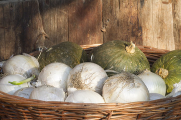 onions and pumpkins in the basket