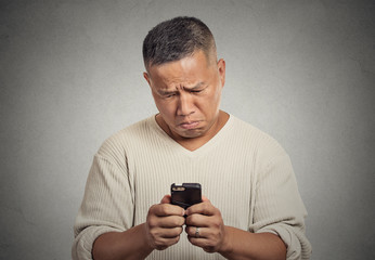 sad upset man seeing bad news email text on cellphone