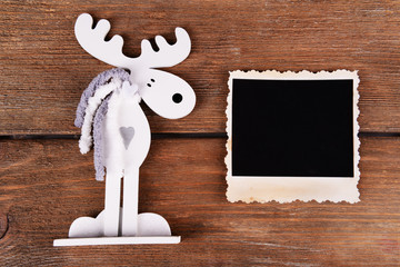 Blank photo frame and Christmas decor on wooden table