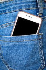 Cell phone in back pocket of girl's jeans
