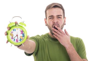 Wall Mural - Yawning guy holding alarm