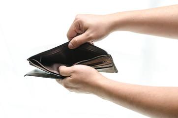 Empty wallet in male hands
