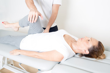 Chiropractic care with elderly woman