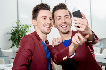 Brothers twins taking selfie photo