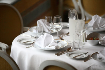 Restaurant set up, fine dining tables, plates and glasses