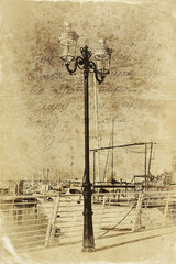 antique street lamp with yacht with black and white style textur
