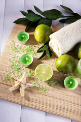 Spa composition with lime, towel and candles