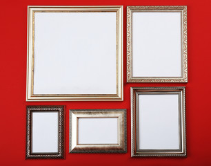 Vintage photo frames on wallpaper background