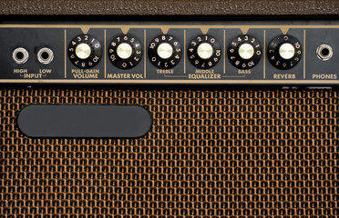 Close up of brown electric guitar amplifier