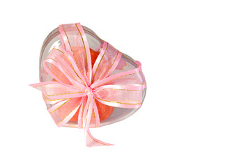 Heart shaped cookie box tied with a ribbon on a white background