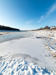 beautiful snowy winter landscape with frozen river