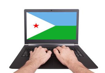 Hands working on laptop, Djibouti