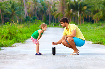 father and son making chemical experiment, funny education
