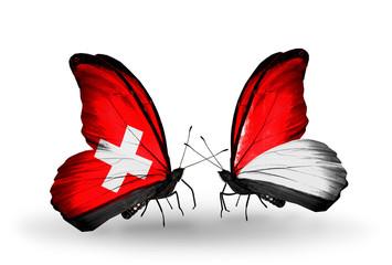 Two butterflies with flags Switzerland and Monaco, Indonesia