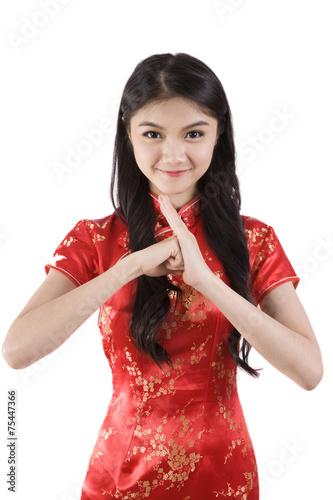 Chinese girl in traditional chinese cheongsam greeting isolated chinese girl in traditional chinese cheongsam greeting isolated m4hsunfo