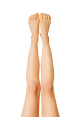 Front view of female nude slim legs up