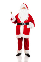Full length Santa Claus holding a bell