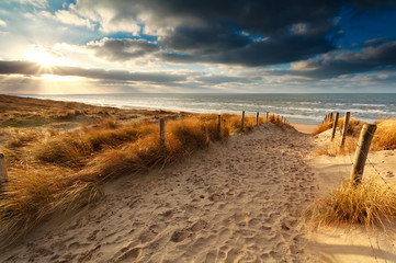 sunset over sand path to North sea
