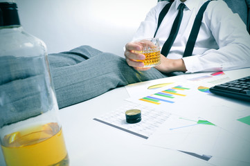 young businessman drinking in the office