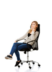 Young woman sitting on armchair touching chin
