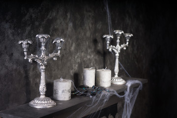 Candles and Candelabras on Creepy Mantle
