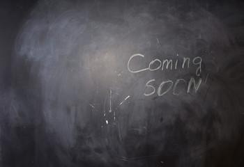 Coming Soon Texts on Black Chalkboard