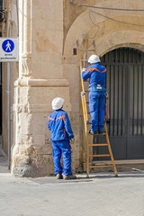 Two workers of the Italian electricity company repairing a fault