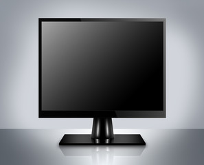 Modern LCD computer monitor on reflective background