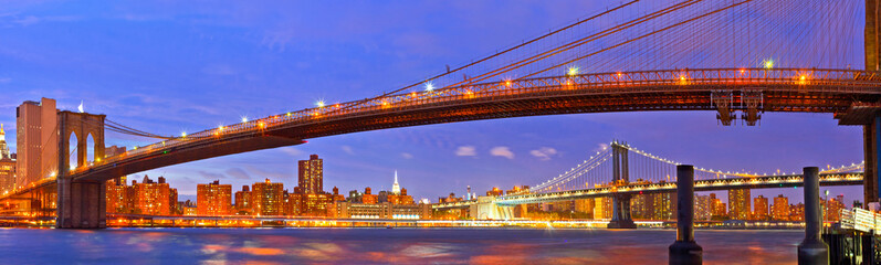 New York City, USA. Brooklyn and Manhattan bridges at sunset