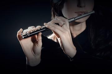 Tuinposter Muziek Flute piccolo with hands closeup