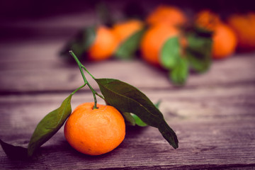 Tangerines on rustic background